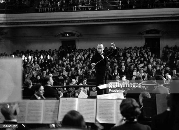 8th October 1938, London, England, Sir Eugene Goosens conducts the London Symphony Orchestra in the Central Hall, Westminster