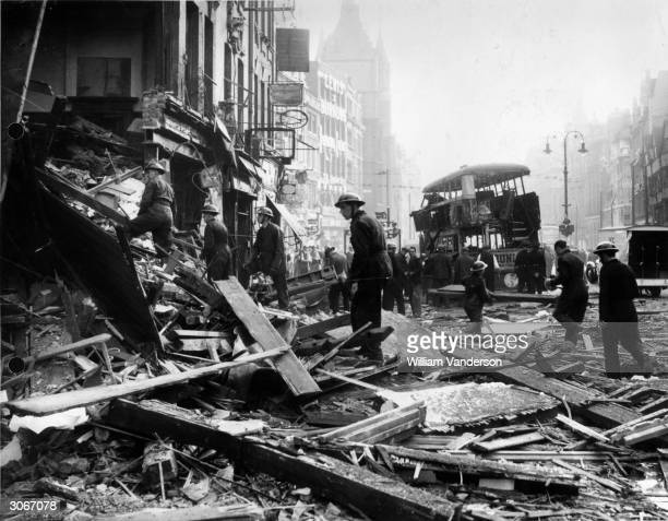 Workers amongst the debris in Holborn, central London, following a daylight raid.