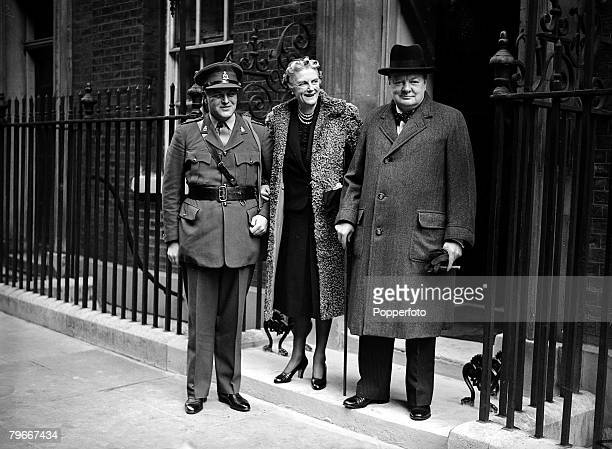 8th October 1940, British Prime Minister Winston Churchill with his wife Clementine and son Randolph Churchill in officers uniform when Randolph...