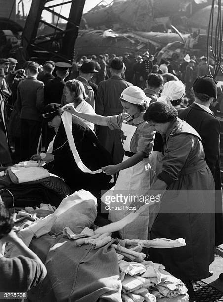 Nurses help the wounded during the aftermath of a triple train crash at Harrow and Wealdstone station It is feared that the death toll could reach...