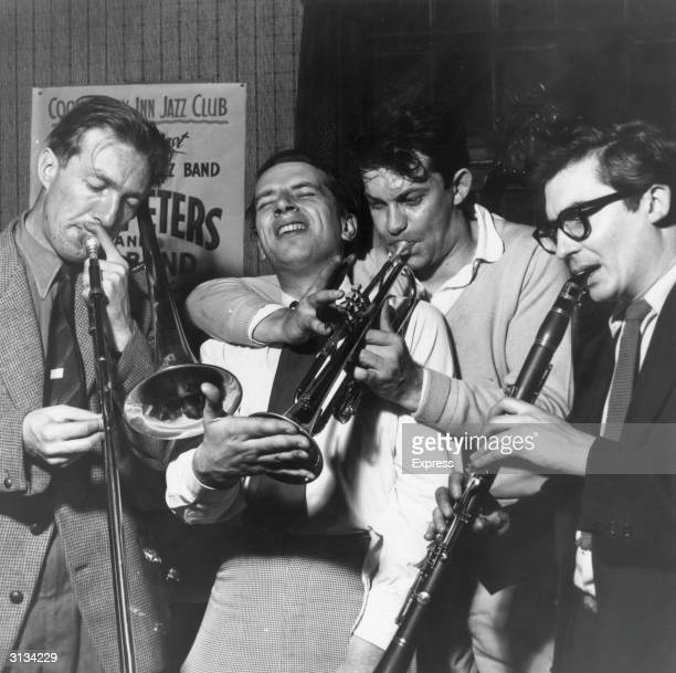 British jazz singer George Melly in performance with his band