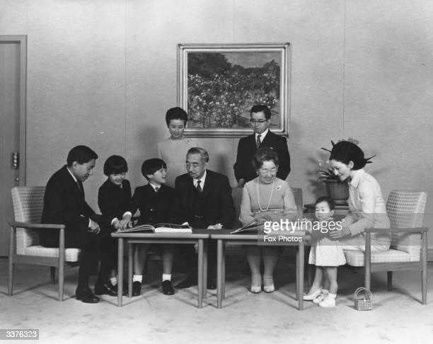 Members of the Japanese royal family at the Imperial Palace Crown Prince Akihito Prince Akishino Prince Naruhito Emperor Hirohito Empress Nagako...