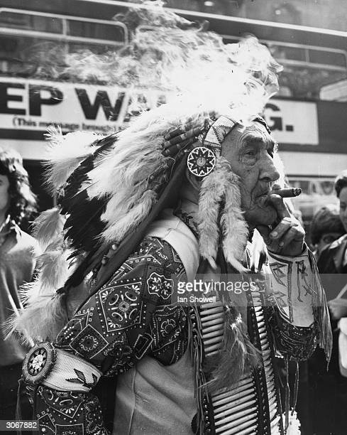 Sioux Chief Red Fox reputedly 101 years old smoking one of his 18 per day cigars which he says give him vitality He is in London to publicise his...