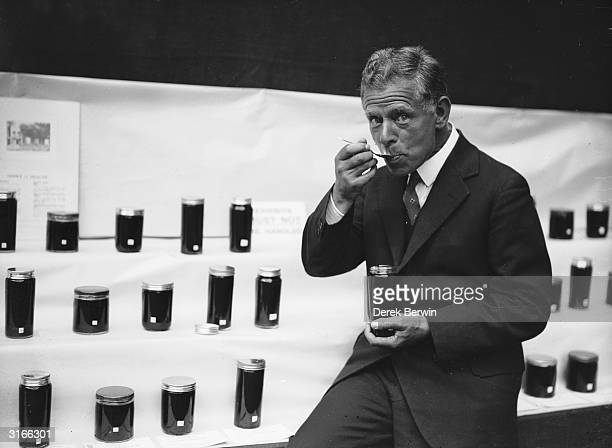 British agriculturalist Sir Edward John Russell tasting some prize honey at the Annual Autumn Show of the British BeeKeepers' Association in the...