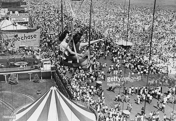 Holidaymakers on a fairground ride at Coney Island America's popular holiday resort in Brooklyn New York