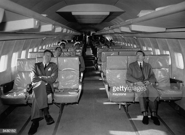 Interior of a giant Boeing 707 jet airliner which can take up to 165 economy class passengers Owned by PanAm she is carrying a service crew for noise...