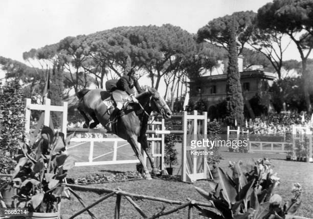 Pat Smythe of Great Britain competing in the Olympic Individual show-jumping even at the Piazza di Siena in Rome.