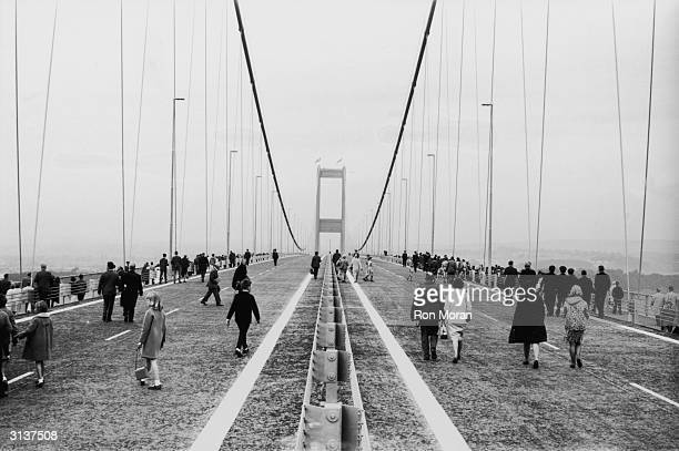 The first crowds cross the new Severn Bridge between England and Wales after its official opening by Queen Elizabeth II and the Duke of Edinburgh