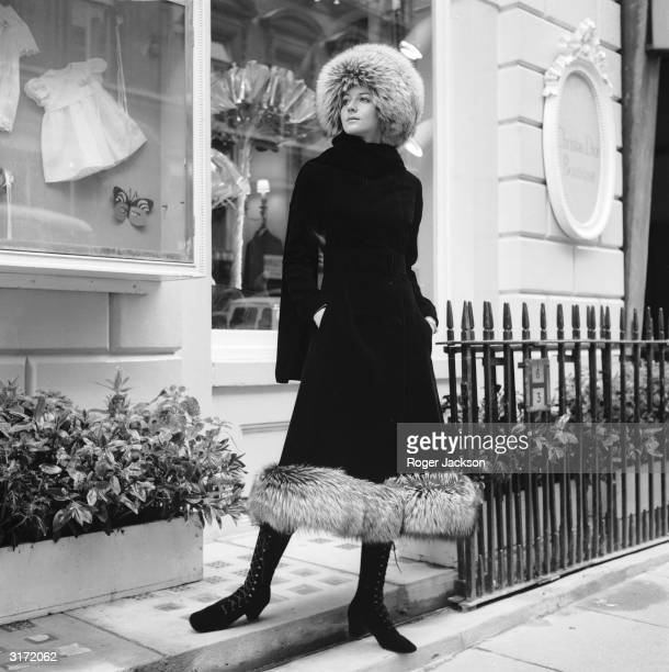 The Christian Dior autumn collection modelled by Lia The outfit comprises of a black velvet coat edged with silver fox a silver fox fur hat and...