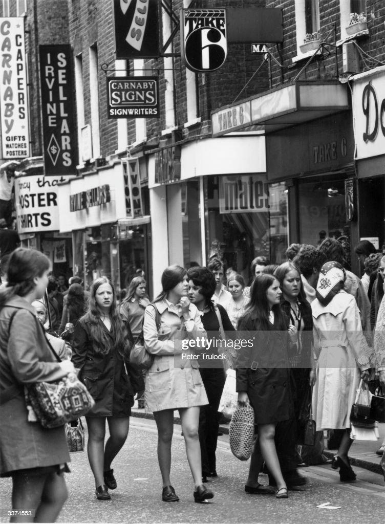 Girls shoppers in Carnaby Street, London.