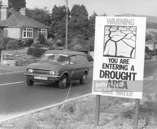 A public information notice warning about the drought erected by the road in the Bridport area of Dorset