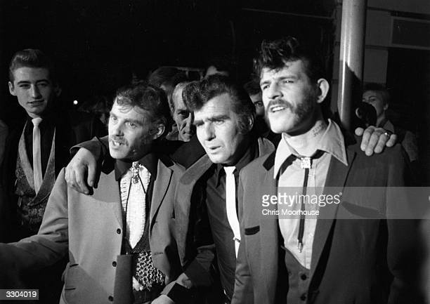 Group of Teddy Boys waiting to see a Buddy Holly film.