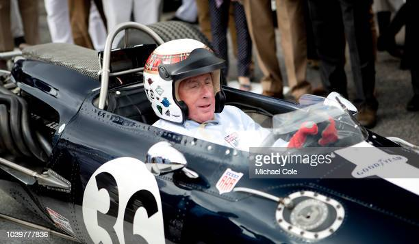 Sir Jackie Stewart in the 1967 Belgian Grand Prix winning car the Eagle Climax Weslake leaving the Assembly Area at the 20th anniversary of the...