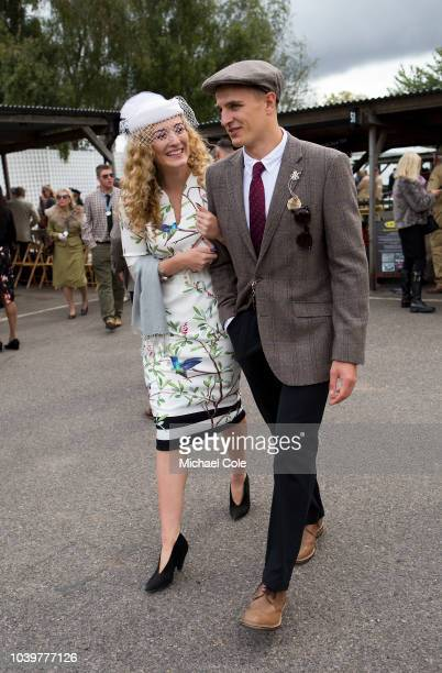 Stylish couple wandering around in the Paddock area at the 20th anniversary of the Goodwood Revival at Goodwood on September 8th 2018 in Chichester...