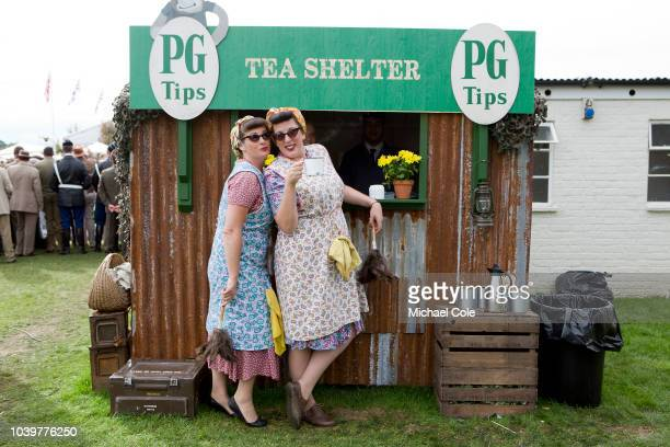 Two 'Char Ladies' pose for photo by the PG Tips Tea Shelter at the 20th anniversary of the Goodwood Revival at Goodwood on September 8th 2018 in...