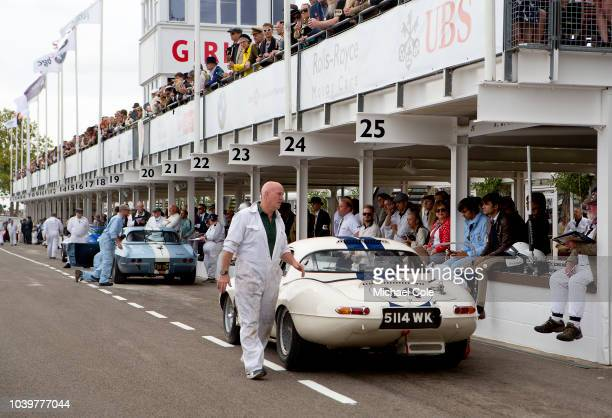 View of the Pit Lane showing a1963 Jaguar Etype 'lightweight' driven by Gary Pearson/Emanuele Pirro in the RAC TT Celebration race at the 20th...