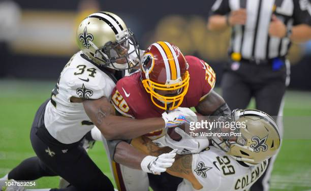 Washington Redskins running back Adrian Peterson is stoppe4d by New Orleans Saints defensive back Justin Hardee and New Orleans Saints strong safety...