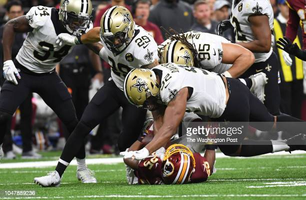 Washington Redskins running back Chris Thompson is stopped by New Orleans Saints defensive tackle Tyeler Davison New Orleans Saints strong safety...