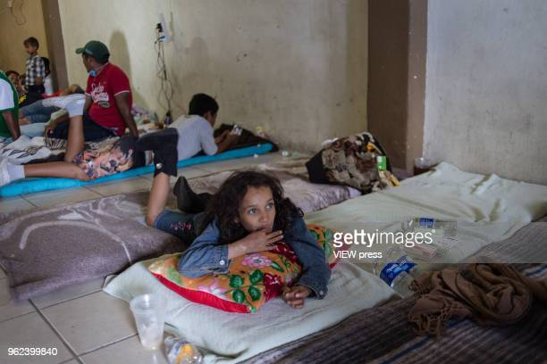 8yearold Ashley who is part of the migrant caravan rests in a shelter on their way through Mexicali to Tijuana and then apply for asylum in the US on...