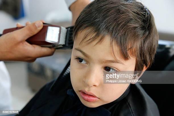 8-year-old boy getting a haircut.