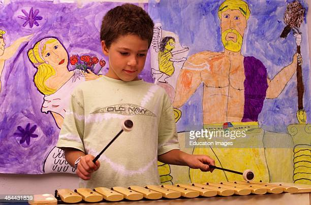8YearOld Boy Playing Xylophone