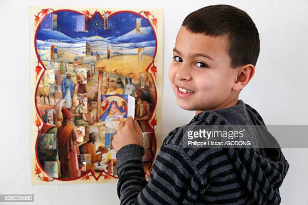 8-year-old boy with an Advent calendar