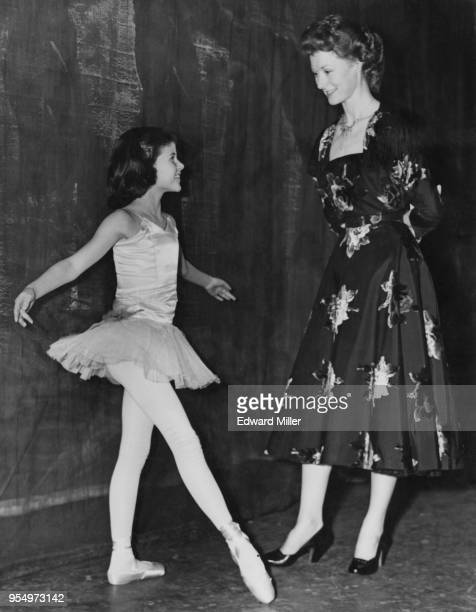 8yearold Caroline Thompson Coon a star pupil at the Legat School of Dancing meets ballet dancer Moira Shearer at the Royal Festival Hall in London...
