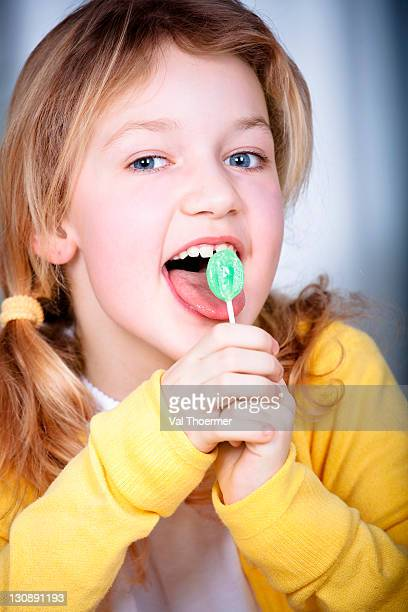 8-year-old girl with lollipop