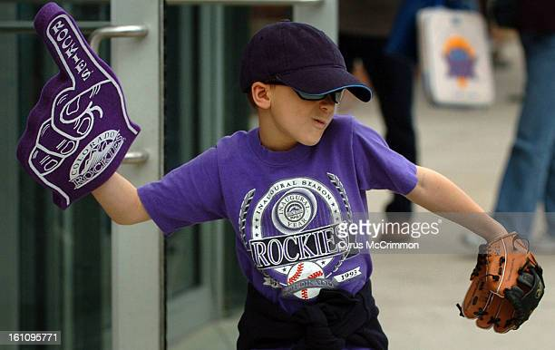 DENVER CO MONDAY APRIL 2 2007 8yearold Ian Hunter dances about on the concourse with a foam finger hand before the Opening Day at Coors Field where...
