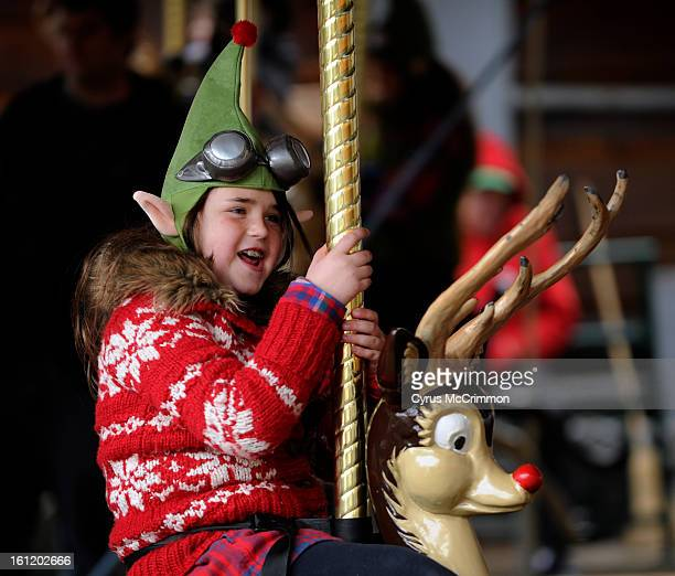 8yearold Skye Winterrowd of Colorado Springs sings Rudolph the RedNosedReindeer as she rides Rudolph on the merrygoround at the North Pole Santa's...