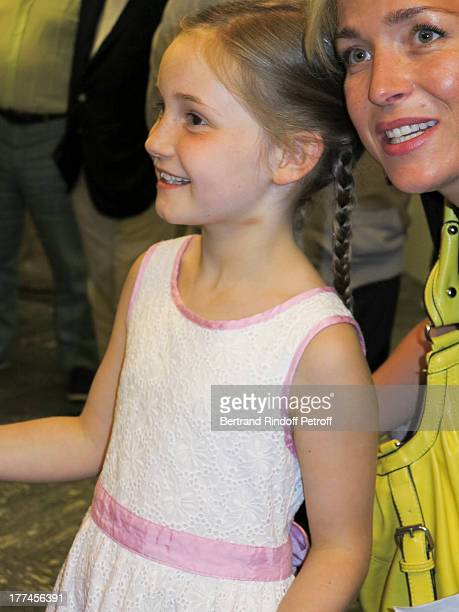 8yearold violin prodigy Alma Deutscher poses with a guest after Alma performed a piece of her own composition alongside the New Russian Quartet as...