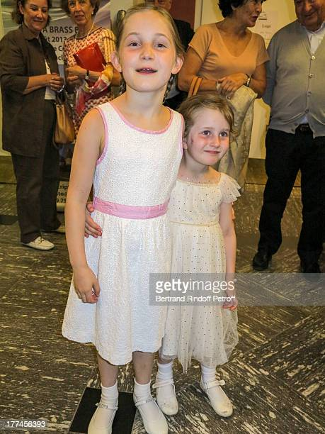 8yearold violin prodigy Alma Deutscher poses with her younger sister Helen after Alma performed a piece of her own composition alongside the New...