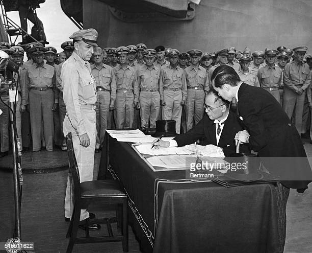 WORLD WAR II JAPANESE SURRENDER Namoro Shigomitso signs on behalf Japan and the Japanese government during formal surrender ceremonies on the USS...