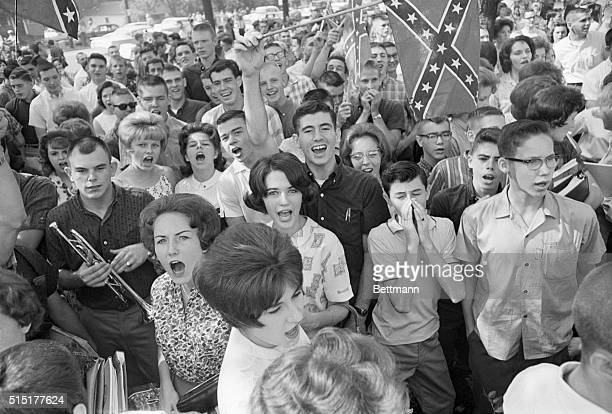 9/10/1963Birmingham AL Demonstrating students wave a Confederate flag as they chant and jeer outside West End High School Three Birmingham schools...
