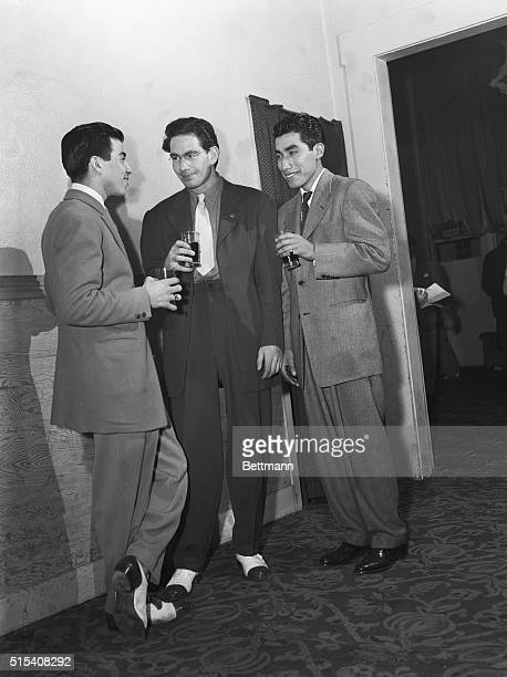 9/11/1942Los Angeles California This trio of 'sharpies' sport their choice wardrobe at a Los Angeles night club It is rumored that the cuffs on some...