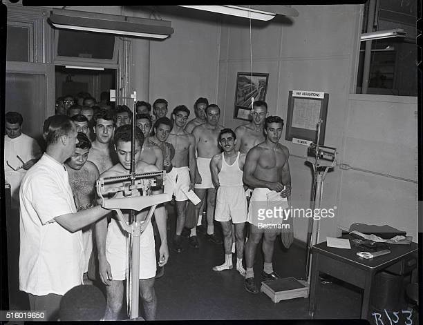 9/11/1951Preinduction physicals Photo shows group of young men taking their preinduction physicals for the Army and the Marines