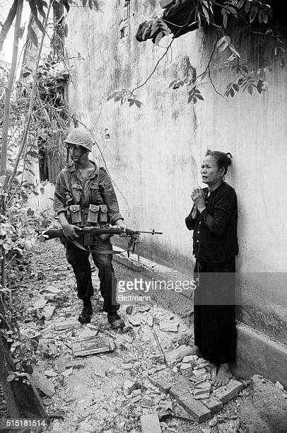 9/11/1965Qui Nhon South Vietnam An old Vietnamese woman folds her hands as if in prayer waiting and watching as US Marines sweep through a village...