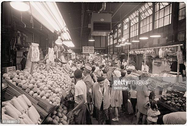 """New York, NY- Puerto Rican shoppers jam the aisles in """"La Marqueta,"""" a five-block-long Spanish American marketplace situated beneath the Penn Central..."""