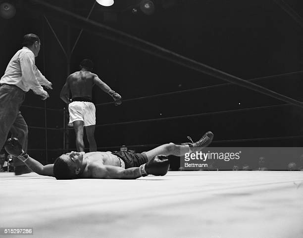 9/12/1951New York NY Britain's Randy Turpin lies on his back after hitting the canvas in the tenth round of his title bout with Sugar Ray Robinson...