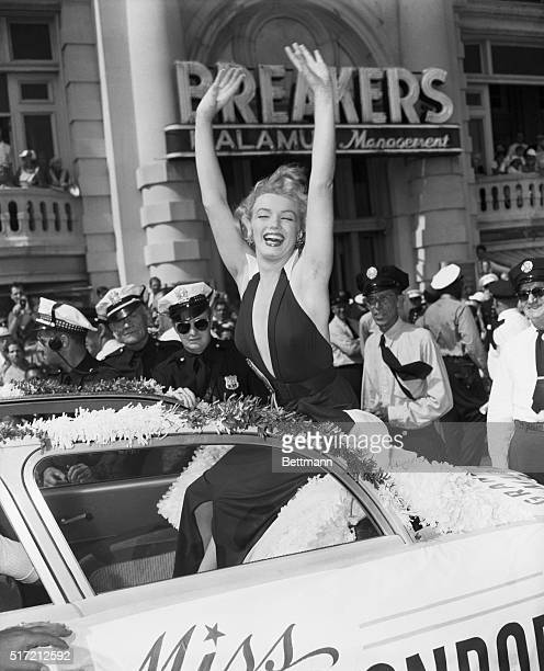 """Atlantic City, NJ: Marilyn Monroe, currently Hollywood's most explosive blonde, assumed the angle as she led the classic """"Miss America"""" pageant down..."""