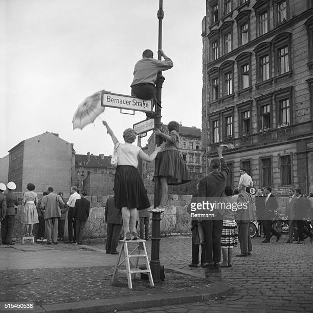 9/12/1961West Berlin Germany Separated from friends and relatives by a solid symbol of the Iron Curtain West Berliners in the French sector use small...