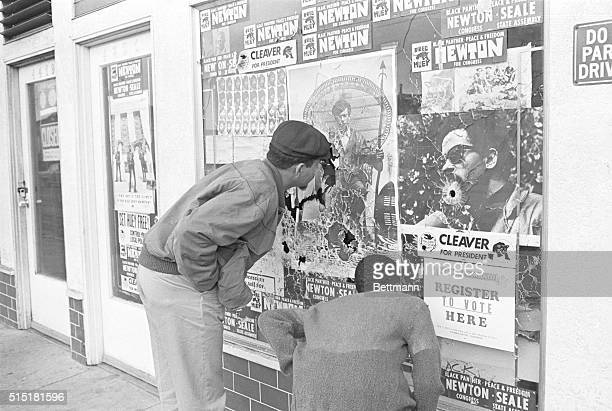 9/12/1968Oakland CA Bystander pokes his finger through one of several bullet holes in window fronting Black Panther headquarters Two Oakland police...