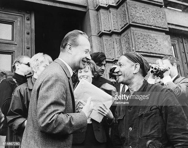 Prague: Mr. Alexander Dubcek, first secretary of the Central Committee of the Communist Party of Czechoslovakia smiles as he chats with a chimney...