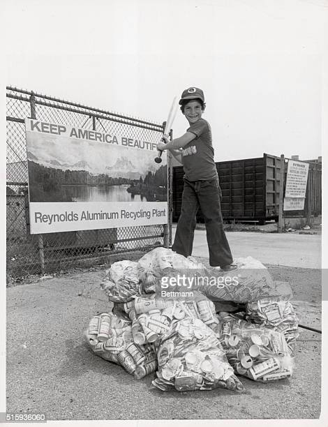 9/12/1973Los Angeles CA Greg Glass of Woodland Hills goes to bat for California's environment after exchanging a wagonload of recyclable aluminum...