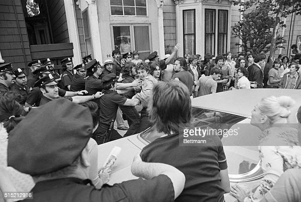9/12/1974Boston MA Police clear area around Boston's South Boston High School after black students arrived for classes at the predominately all white...