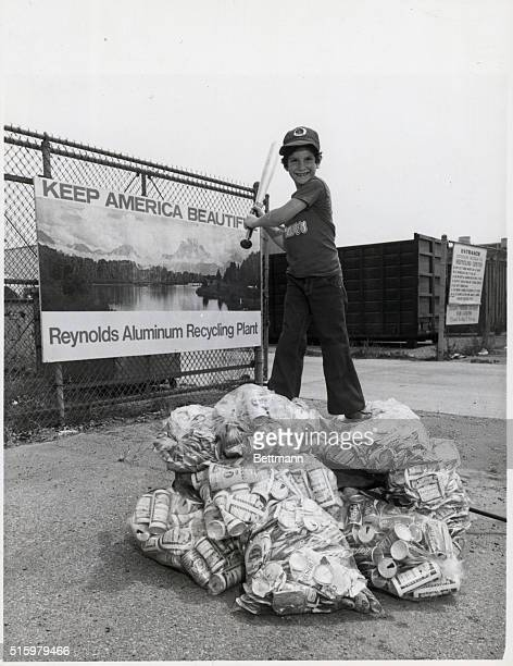 9/12/73Los Angeles California Greg Glass Woodland Hills goes to bat for Californias' environment after exchanging wagonload of recyclable aluminum...