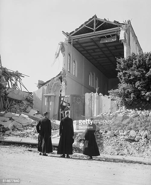 9/13/1954Orleansville Algeria Three Roamn Catholic preists gaze at the Cathedral of Saint Peter and Saint Paul in Orleansville which was almost...