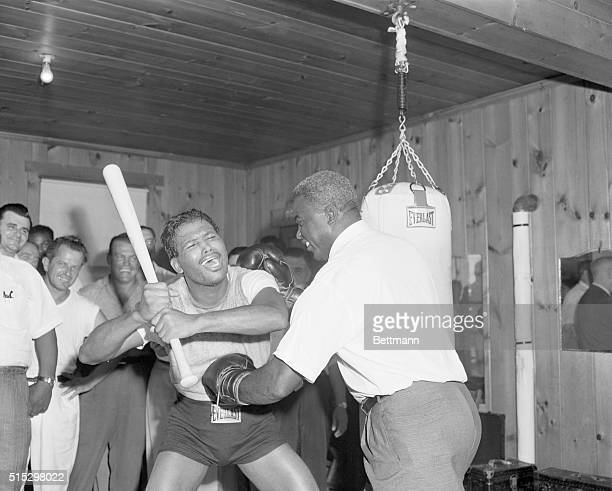 Greenwood Lake, NY- Welterweight champion Sugar Ray Robinson, in training for his September 23rd middleweight bout with Carmen Basilio, brandishes a...