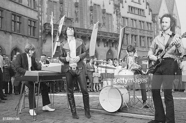 9/13/1968Frankfurt Germany Jim Morrison leader of The Doors singing group is shown with bandmates performing outside of the Town Hall today for the...