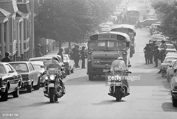 9/13/1974Boston MA Helmeted police protect route as school buses carrying black students receive a motorcycle escort upon arrival at South Boston...